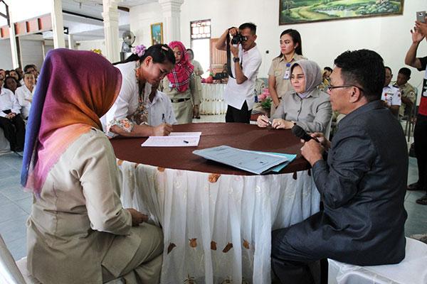 walikota-hadiri-kegiatan-pencatatan-akta-nikah-massal-se-kotamobagu-3